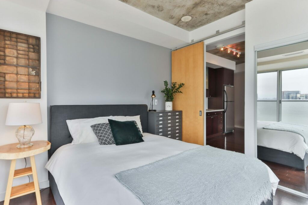 Bedroom with wood and cement features