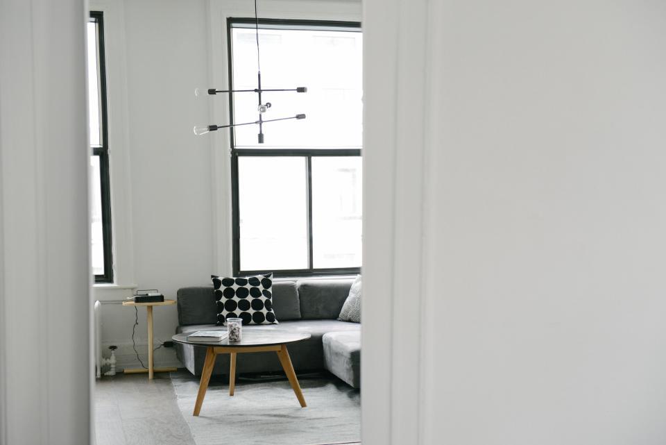 White and black furniture in studio apartment